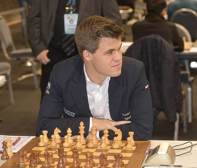 World Champion Magnus Carlsen, playing his first game of the tournament, suffered a loss against arch-rival Levon Aronian (not in the picture). [Picture Source: etcc2015.com]