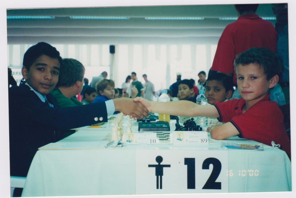 Deep enroute to his World Championship title! Can you guess his opponent and the grandmaster next to his opponent?